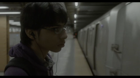 Ricky in subway station as train pulls in